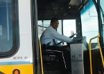 Bus Operator pressing button to lower bus.