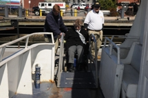 customer using bridgeplate to board boat. Click to enlarge.