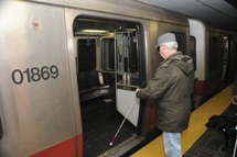 Customer using white cane to board train. Click to enlarge.