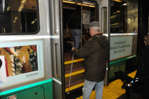 Customer with visual impairment boarding Green Line train. Click to enlarge.