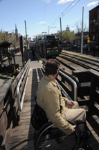 Customer using wheeled mobility away from platform edge of mini-high platform. Click to enlarge.