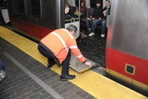 MBTA member of staff positioning bridgeplate. Click to enlarge.