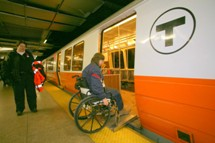 Customer using wheeled mobility wheeling onto train. Click to enlarge.