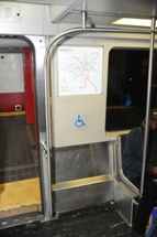 Seating areas for customers using wheeled mobility on Red Line Train. Click to enlarge.