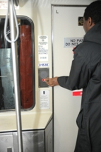 Customer pressing button to speak with train operator. Click to enlarge.