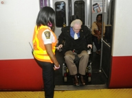 Customer using wheeled mobility device exiting train without using bridgeplate. Click to enlarge.