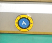 ISA button near center doors of low-floor Green Line train. Click to enlarge.