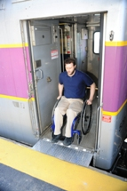 Customer near train doors. Click to enlarge.