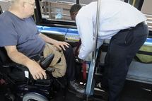 Bus Operator unsecuring a wheeled mobility device.