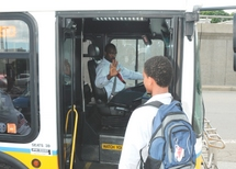 Bus Operator preboarding a customer in a wheeled mobility device.