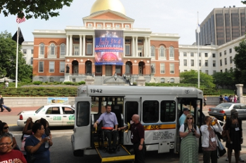 The Ride bus assisting customer in front of State building